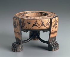 Ceramic black-figure three-legged vessel depicting a pair of wrestlers. Greek. Archaic Period. 6th century B.C. | Museum of Fine Arts, Boston