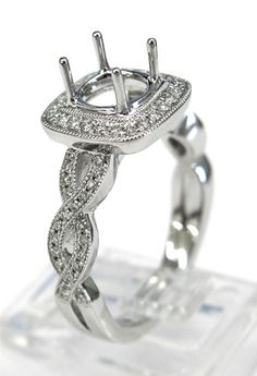 Ladies 14kt white gold semi mount. Mounted in ring are 68 brilliant round cut diamonds weighing a total of .29ct. Mounting is made to take a 1ct round cut diamond in the center.
