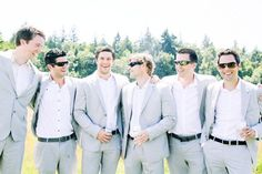 light grey groomsmen suits - no ties but with suit jackets ...