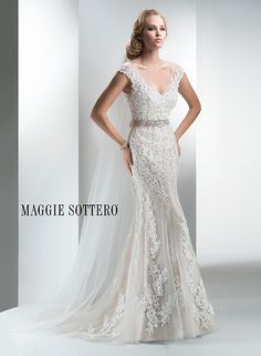 Bold floral lace lay atop soft tulle in this stunning sheath wedding dress, Lucinda, by Maggie Sottero. We love the illusion lace cap-sleeves dusting the shoulder!