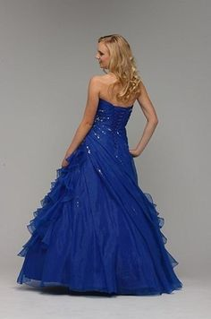 A strapless organza gown with a ruched bodice and skirt with beading to one hip by Berketex