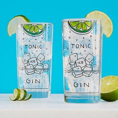 These highball glasses are illustrated with the essential ingredients of a gin & tonic.