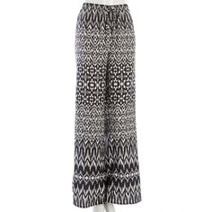 Glam up any solid swimsuit with these tribal inspired cover-up pants. The soft fabric and simple elastic waist make them ideal for lounging by the water or to wear as an all-occasion pant. Beaded drawstring accents add a chic touch.