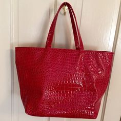 Big cherry red croc print tote bag Great big roomy tote bag in candy apple/cherry red, faux croc print. Good used condition, clean, no rips or tears; only signs of use are two small spots where finish is rubbed off: one at top near left on bottom edge (which you can see in pic of bottom of bag), & at top right corner (so small doesn't even show in pic). If you want a new perfect bag, this ain't it, but if you'd like a sharp looking, practical tote bag at a low price in good used condition…