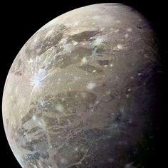 "The Solar System's top 5 most amazing moons! | Ganymede: ""The largest moon in the entire Solar system, and the third of Jupiter's Gallilean moons. Voyager picked up a weird radar echo from inside Ganymede. The most likely explanation is that it's also hiding a subsurface ocean of saltwater. It's also the only moon with a magnetic field – just like Earth!"""