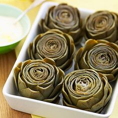 If you've never made artichokes, try this easy side-dish recipe. Served with the homemade lemon-mayonnaise dip, it's sure to impress your guests.