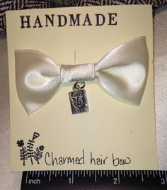 PASSPORT charm ivory hair bow. FREE SHIPPING!!  #bunnyrootsbows Find us on eBay, etsy, and Facebook. All handmade by me!