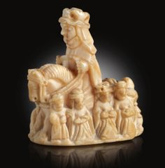Chess Queen -- English or Scandinavian, circa 1400 -- incised: VILLET and with a label inscribed: WOA 1403 in ink to the underside -- walrus ivory -- 2 5/8 inch --- sold at Sotheby's for £277,250