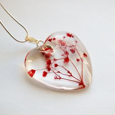 Real Flower Red Necklace 04 Mother's Day Love Heart   Botanical Tiny Real Flowers Glass Pendant Ice Crystal Wearable Art: Baby's Breath. $28.00, via Etsy.