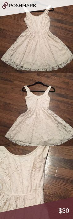 Zara delicate lace dress. Size Medium. Delicate fun knee length lace dress with button at back and invisible side zipper. Only worn once. Zara Dresses