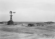 Dorothea Lange  Abandoned farm with windmill and farm equipment. Dalhart, Texas. June 1938.