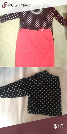 Black 3/4 sleeve polka dot shirt Says it is a size U.K. 8. Fits like a small. Very cute with jeans or a pencil skirt. The shirt is somewhat thin. Tops