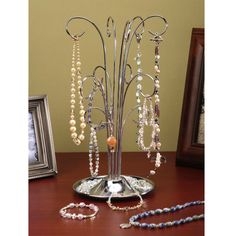Add a fashionable touch to your jewelry displays! This stylish silver-colored jewelry stand...