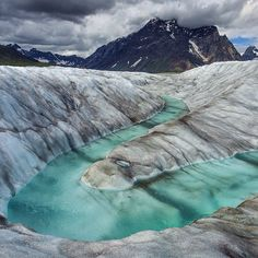 Photo by @argonautphoto (Aaron Huey). A glacial stream meanders across the #RuthGlacier in #DenaliNationalPark revealing the green tinted ice below the snow and silt covered surface. The Ruth was my favorite place to work while on assignment covering #Denali for our National Parks series. The story comes out in early 2016! Follow @argonautphoto to see more images from this assignment! by natgeo