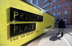 A pedestrian passes a hoarding surrounding the construction site of Principal Place, a joint development by Brookfield Property Partners LP, Concord Pacific and W1 Developments, in London, U.K., on Wednesday, April 1, 2015. Principal Place in Shoreditch, directly north of the City of London financial district, will include Principal Tower, a 50-storey residential apartment block, and also the office building that Amazon Inc. agreed to lease as its new U.K. headquarters. Photographer: Chris…