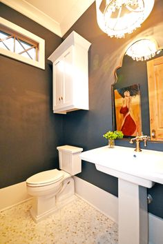 Gorgeous Powder Bath with black walls and Calcutta marble penny tile Casiewebbdesigns Ketteringham Builders