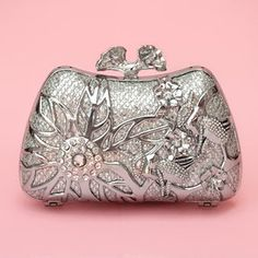 Spring Bloom Crystal Clutch by Kate Ketzal, only $125, gorgeous and reasonably priced.  Perfect for that silvery vintage wedding gown I posted earlier today.  :)