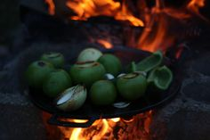 Roasting Tomatillos over the fire for Salsa Verde.