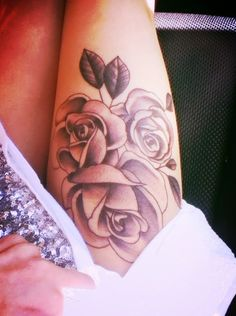 Three roses like this without the leaves, down the side of my right thigh