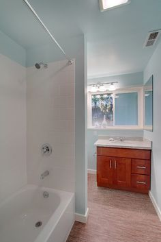 Seattle Montlake Terrace Mid Century Modern - Sherwin Williams Tidewater is beautiful in bathrooms for a clean feel and looks great with orangey wood tones.