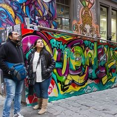 Taken in Melbourne's lane ways famous for all the street art you see behind us, this pic holds special memories. We fell in love with the vibrancy of Melbourne, the hip melting pot of cultures, the incredibly innovative food all thanks to our friends who are locals and ensured we experienced the best of the best!  #street #streetart #melbourne #australia #colours #graffiti #art #downunder #melb  #laneways  #travelblogger #instatbn #instatravel #travel #tourist
