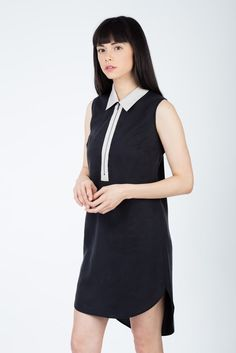 $103- 100% Tencel The Zip up dress with a curve hem and collar featuring a modern edge with a zip up front  Clean by design, Tencel is made from recycled wood cellulose and is more absorbent than cotton, extraordinarily soft and cooler than linen. Perfect little black dress
