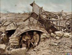 Two Australian Soldiers relaxing under an 'Elephant Iron' shelter at Westhoek Ridge, Flanders, Belgium. c. Late September 1917. [Colorized by Royston Leonard]