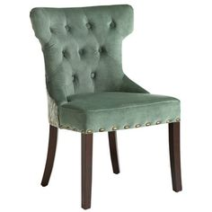 Elegant hourglass chair in rich blue with hand-placed button tufts, deep comfortable padding, nailhead trim all around and an ornate damask pattern on back. Hardwood legs are gently tapered and curved. Technical term: Swanky.