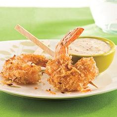 Coconut Shrimp | MyRecipes.com [i've never had something EVER toast up crispy like this in the oven, but i'm ever-hopeful!]