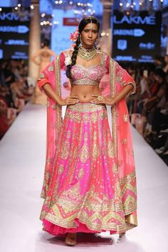 Powerhouse fashion designer Suneet Varma sparkled down the Day 4 Lakmé Fashion Week runway with his custom outfits inspired by the traditions of Gujarat, Rajasthan, Punjab and South India. His color combinations spanned the rainbow and he had glitz and mirrored embellishments on each and every outfit.