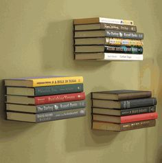 Upcycle Us: Use bookends to create a floating bookshelf. Now we have a use for all of those old metal book ends I wanted to throw out! :) Can even paint them and use them in the kids rooms.