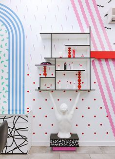 Mix up the colours and patterns; add some cool accessories; et voila...a fun and vibrant wall