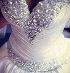 Stunning. Bedazzled wedding dress. Ball gown shaped fit with sweetheart neckline.