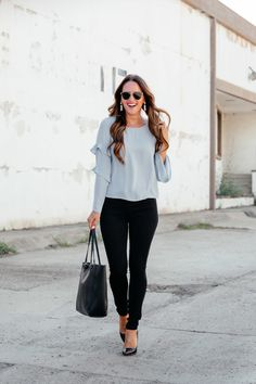 Lauren Morgan wearing black skinny jeans from the Nordstrom Anniversary Sale