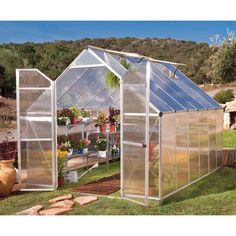 Essence 8 x 12 Twin-Wall Glazing Silver Palram Greenhouse, Silver. This greenhouse features high headroom and wide double doors for improved access and working space. Set up is easy and fast with the SmartLock Panel system.