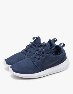 From Nike, a modern runner in Midnight Navy. Inner sleeve construction. Padded collar. Heel pull tab. Round woven laces. Nike branding throughout. Molded traction pattern.   • Textile upper • Three-foam density midsole • Rubber outsole • Women's size
