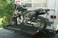 Custom Motorcycle Carrier on the back of a RV Travel Trailer - Every_Miles_A_Memory
