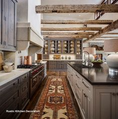 Rustic Kitchen with greywashed perimeter cabinets, pale grey kitchen island and reclaimed beams. Kitchen island countertop is Aged Petite Granite. Perimeter countertop is Calacatta Marble. Cabinet Hardware is Rocky Mountain Hardware. Grey Kitchen Island, Rustic Kitchen Design, Farmhouse Kitchen Cabinets, Modern Farmhouse Kitchens, Interior Design Kitchen, Country Kitchen, New Kitchen, Cool Kitchens, Kitchen Ideas