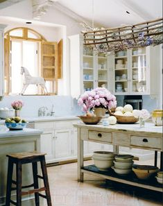 Rustic French Country Kitchen from Cote Sud home decor magazine from France.A hallmark of French Country Look is a painted and distressed furniture, and walls that have a crumbling old plaster feel.