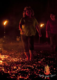 """A firewalking participant firewalking at one of Claudia Weber's """"Ignite your Spirit"""" Empowerment Seminars & Firewalking events!  The fire was so intense that it was creating a breeze across the firewalk pad. Fun times!  www.firewalkwithclaudia.com"""