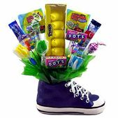 Everyone will love this uniquely arranged Easter candy bouquet in a resin sneaker of navy blue.   A heartfelt gift for someone special, this blue sneaker is filled with yummy candies including marshmallow Peeps, Laffy Taffy Airheads, Twinkle Pop Tulips and more.   • A heartfelt gift for someone special  • Features: Resin Navy Blue Sneaker  • Features: Yummy Easter Candy, Peeps, Taffy, Airheads and more