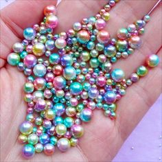 Assorted round pearls in beautiful rainbow gradient and various sizes. Excellent for resin crafts, phone case decoden, magical jewelry and accessories making, a