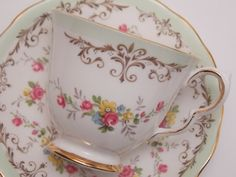 Queen Anne Fine Bone China Tea Cup and Saucer Green and Brown Border Floral Pattern Gold Trim