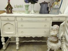 Gorgeous Shabby Chic White Antique Buffet on Wheels with Oh so many drawers and includes a matching Dining Table & Chairs, and Hutch