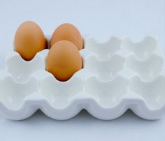 Ceramic Egg Rack by Living Royal @ Uncovet  // wow, yes, i could do this. I could recycle my organic eggs' carton and use this.