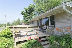 4934 E Buckeye Road Madison, WI $180,000 Beautiful Start! Well-maintained home with1530 square foot, 3 bedroom + office, 2 bath raised ranch. The real hardwood floors gleam from all the natural light. Features an eat-in kitchen, garden window & a gas range. Roomy lower level includes ¾ bath, family room & office/den.