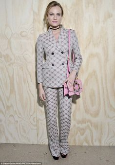 Busy bee: Diane, who recently split from her long-term boyfriend Joshua Jackson, went for business meets bedtime in a floral-print trouser suit