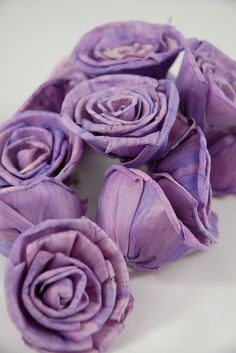 """Um, COOL. These are called """"Sola roses"""" and they're carved from tapioca wood. Pretty!"""