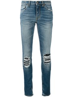 Saint Laurent Ripped Detail Jeans. Distressed Skinny ... c47bf5deae