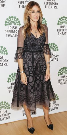 Sarah Jessica Parker in a sheer black-embroidered gray Temperley London organza dress, styled with black pumps.